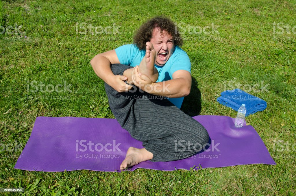 Funny yoga and fat guy on the nature. stock photo