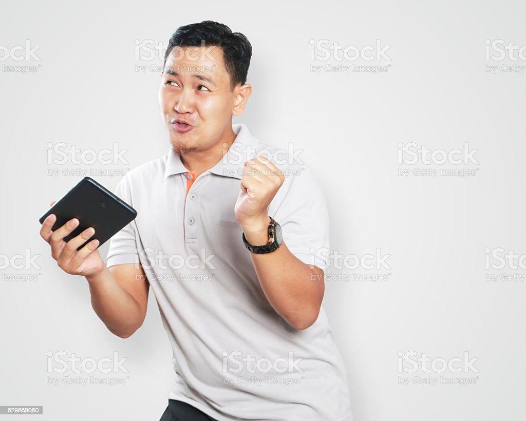 Funny Young Asian Guy Dancing stock photo
