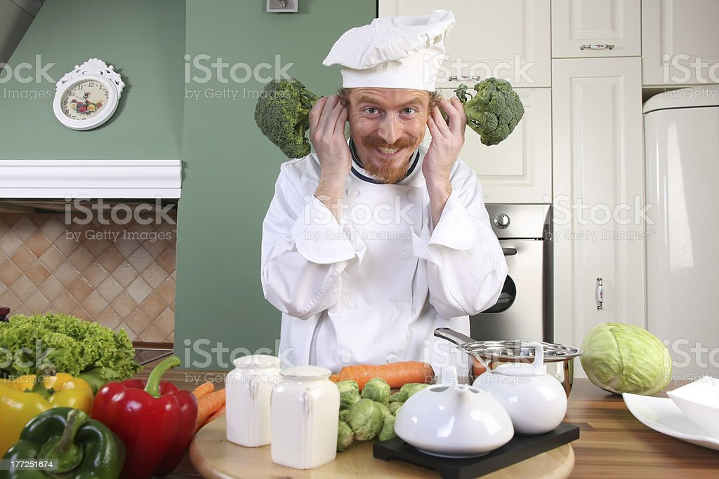 Funny young Chef with broccoli royalty-free stock photo