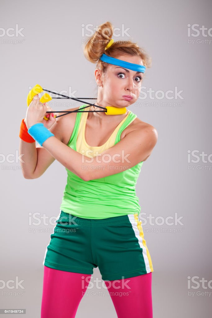 Funny young fitness girl doing stretching exercises stock photo