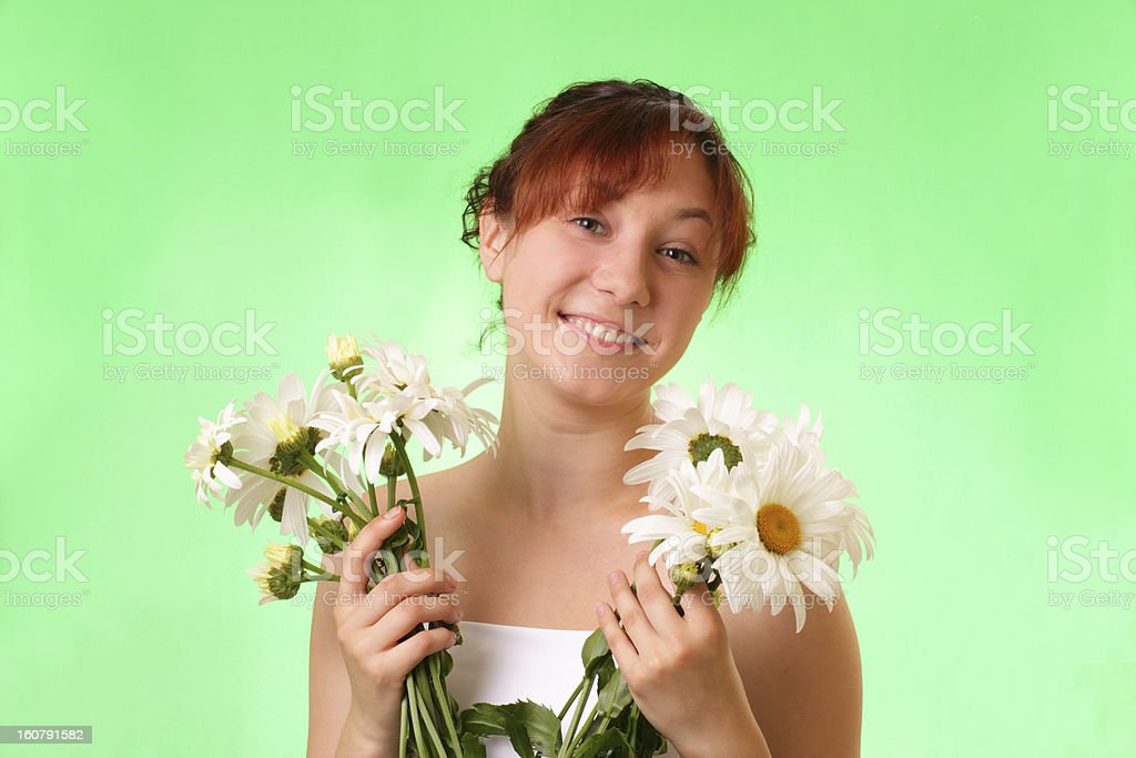 Funny young girl with chamomile flowers royalty-free stock photo