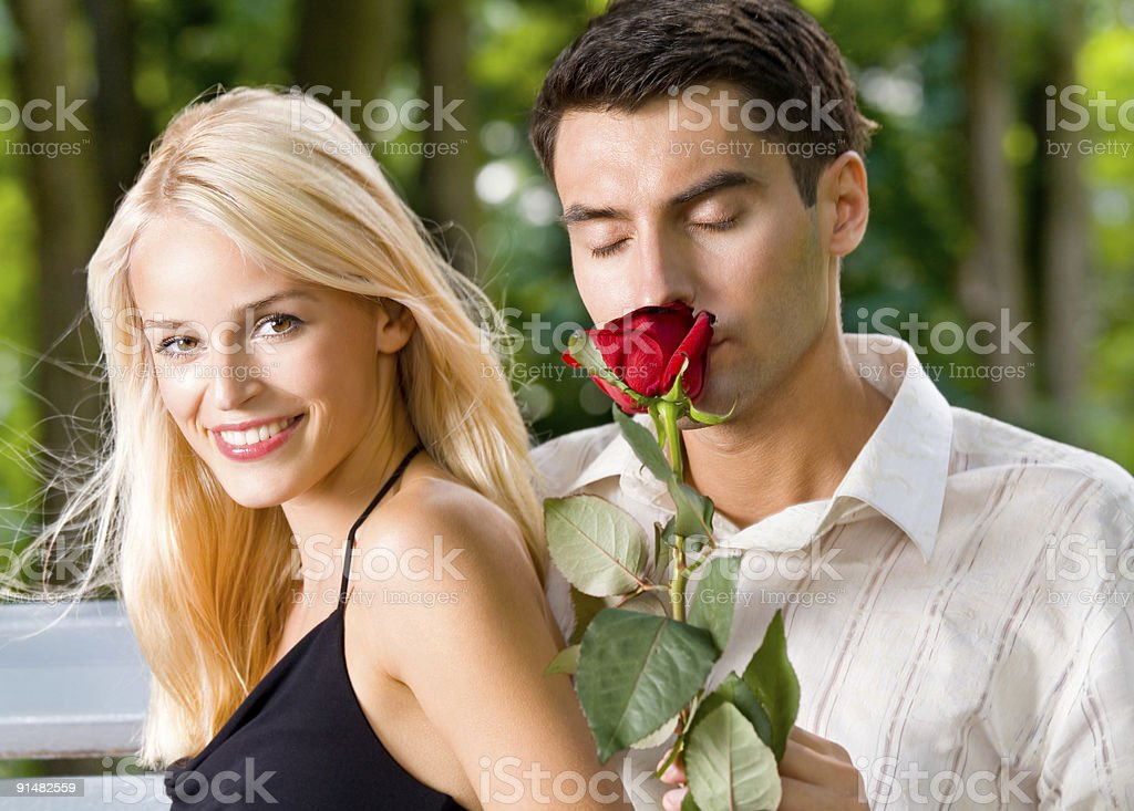 Funny young happy couple with rosa, outdoors royalty-free stock photo