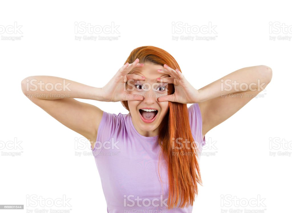 funny young woman, fingers keeping eyes open, trying to stay alert focused, surprised, shocked stock photo