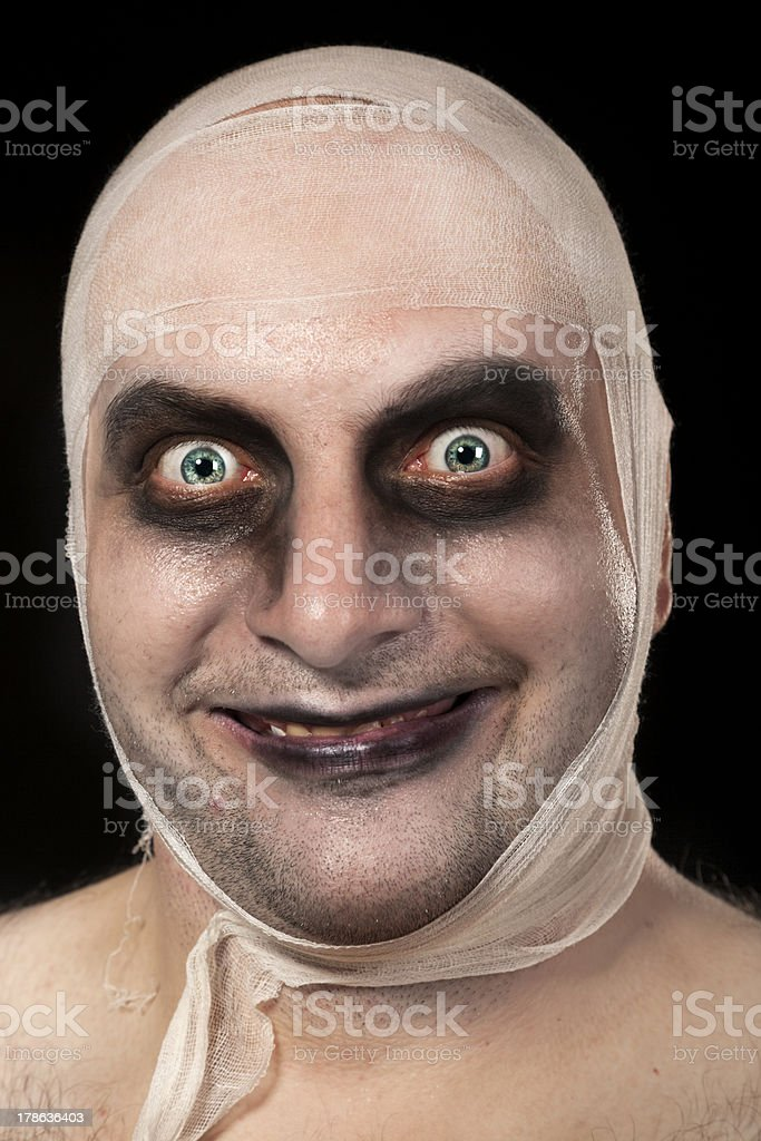 Funny zombie with bandages around his head stock photo