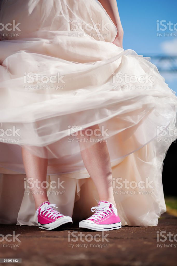 Funy bride in sneakers stock photo