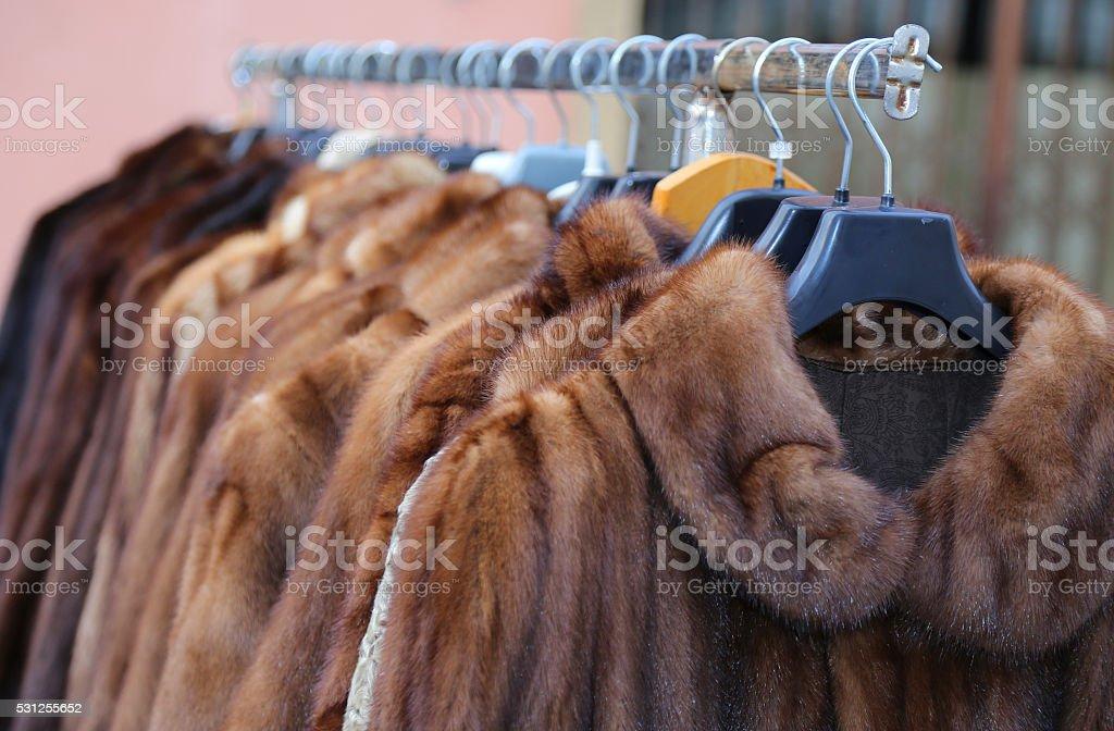 fur coat for sale in the flea market stock photo