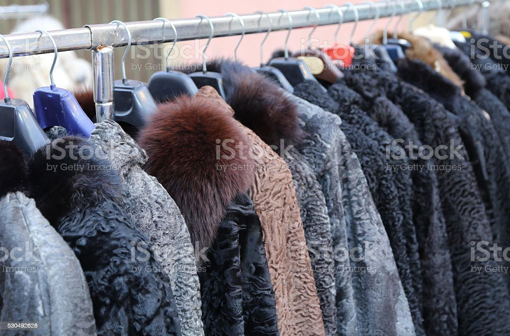 fur coat in vintage style at the flea market stock photo