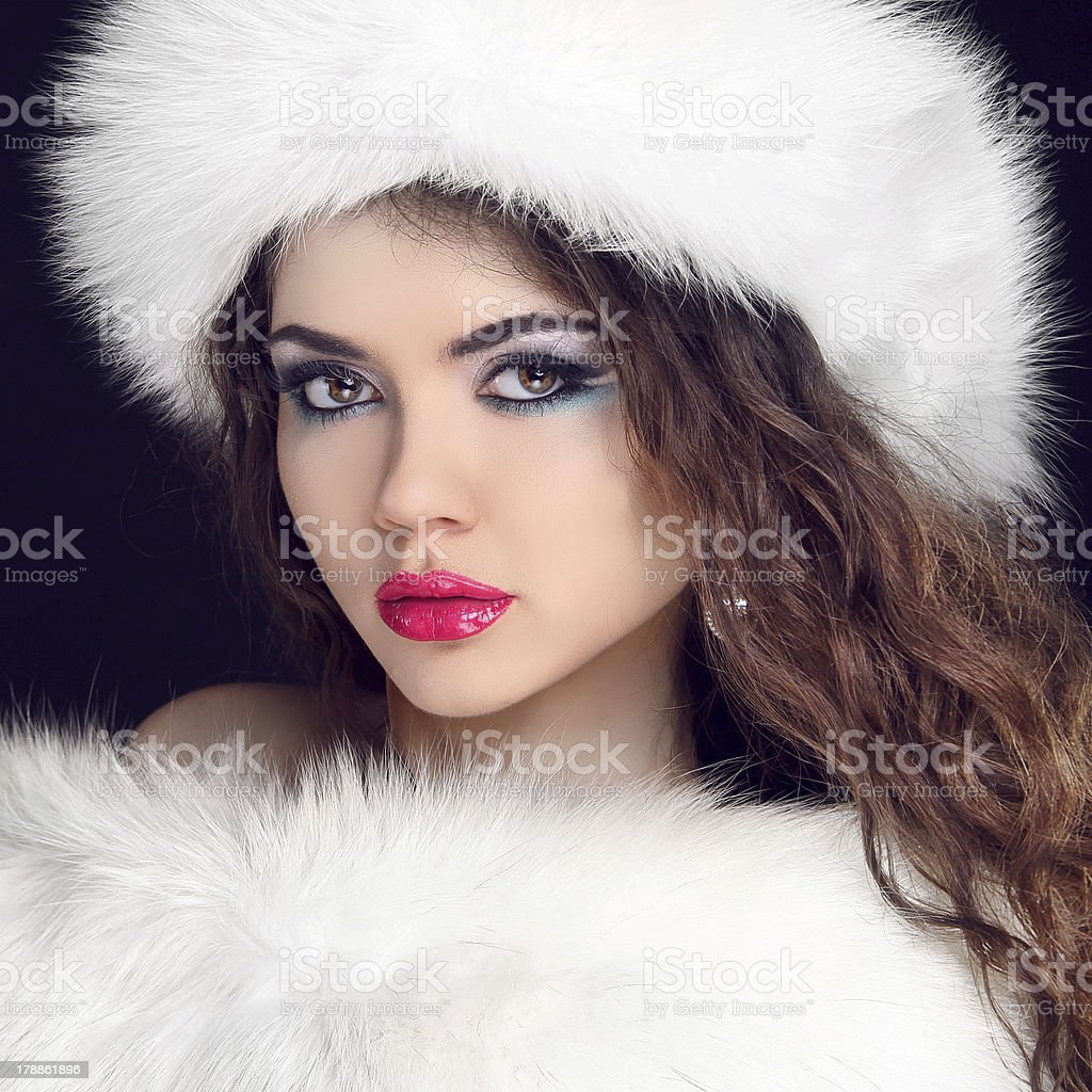 Fur Fashion. Beautiful Girl in Furry Hat. Winter Woman Portrait royalty-free stock photo