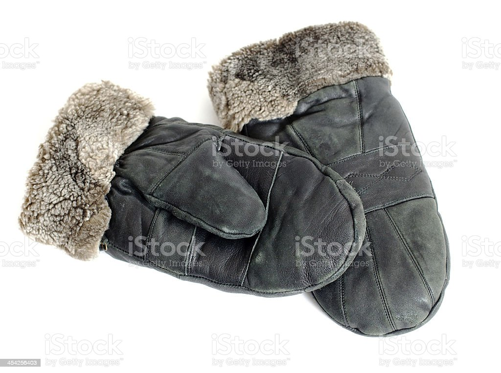 fur suede mittens on white background royalty-free stock photo