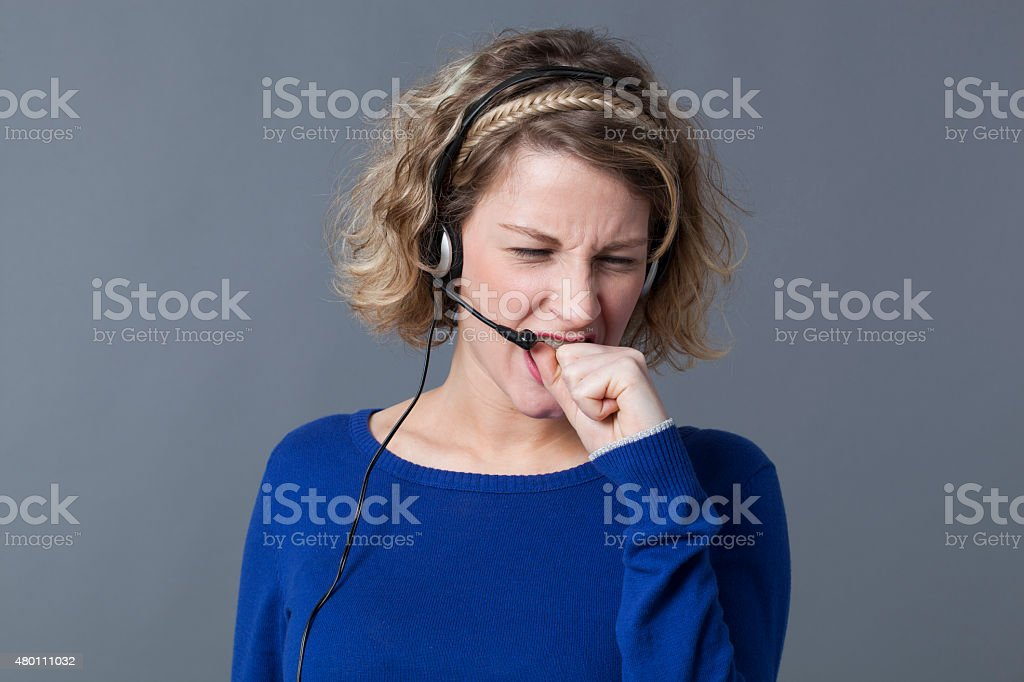 furious 20s blonde entrepreneur loosing her temper on the phone stock photo