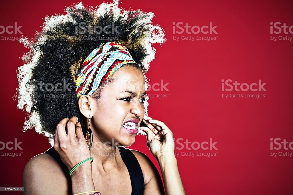 Furious afro-haired cutie grimaces and shakes fists royalty-free stock photo