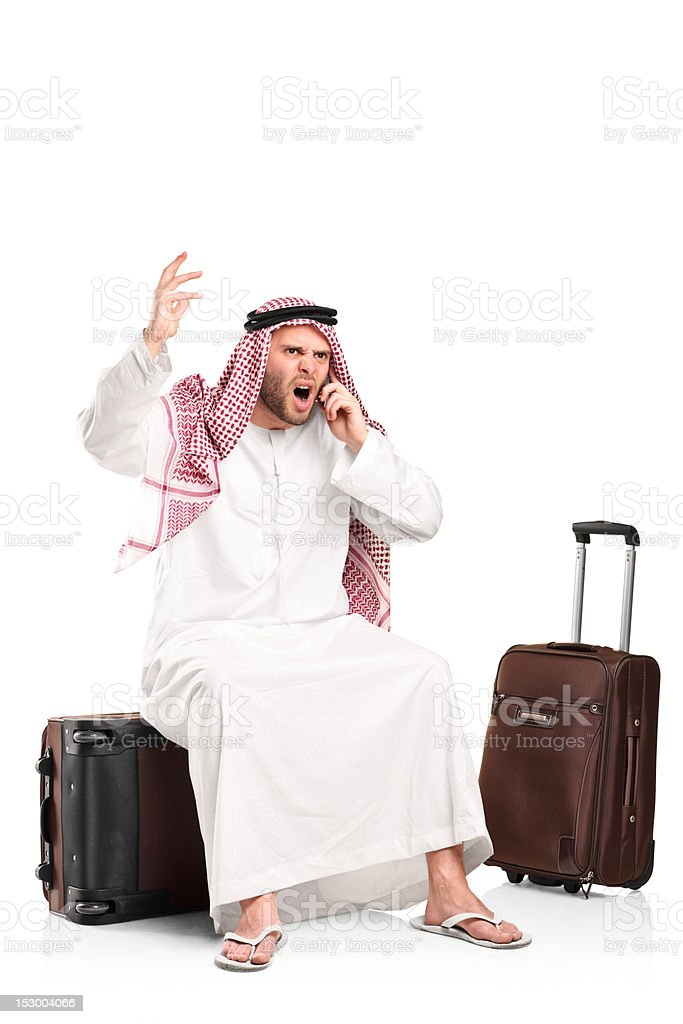 Furious arab shouting on a mobile phone royalty-free stock photo