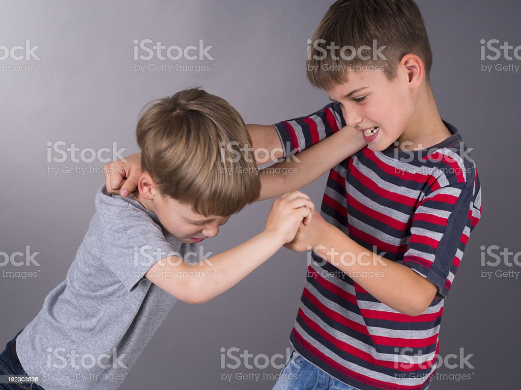 furious brothers fighting stock photo