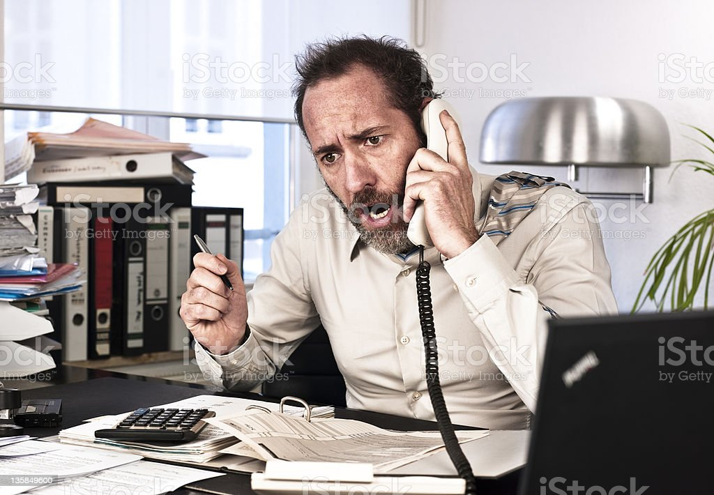 Furious Businessman on the phone royalty-free stock photo