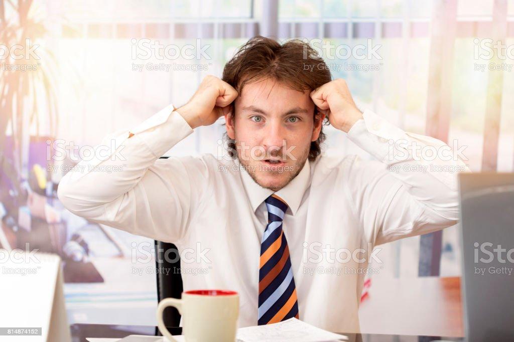 Furious businessman stock photo