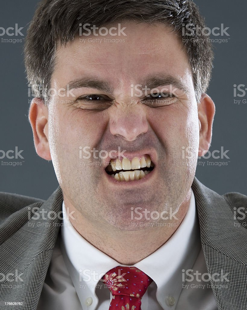 Furious Businessman Showing Yellowed Teeth royalty-free stock photo