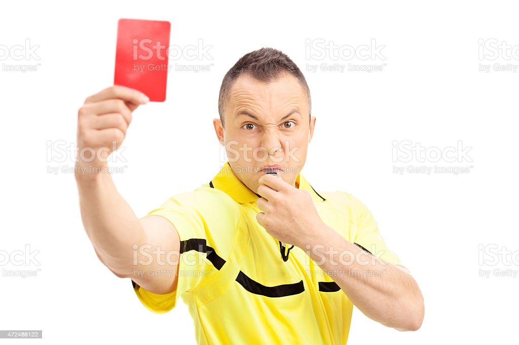 Furious football referee showing a red card stock photo
