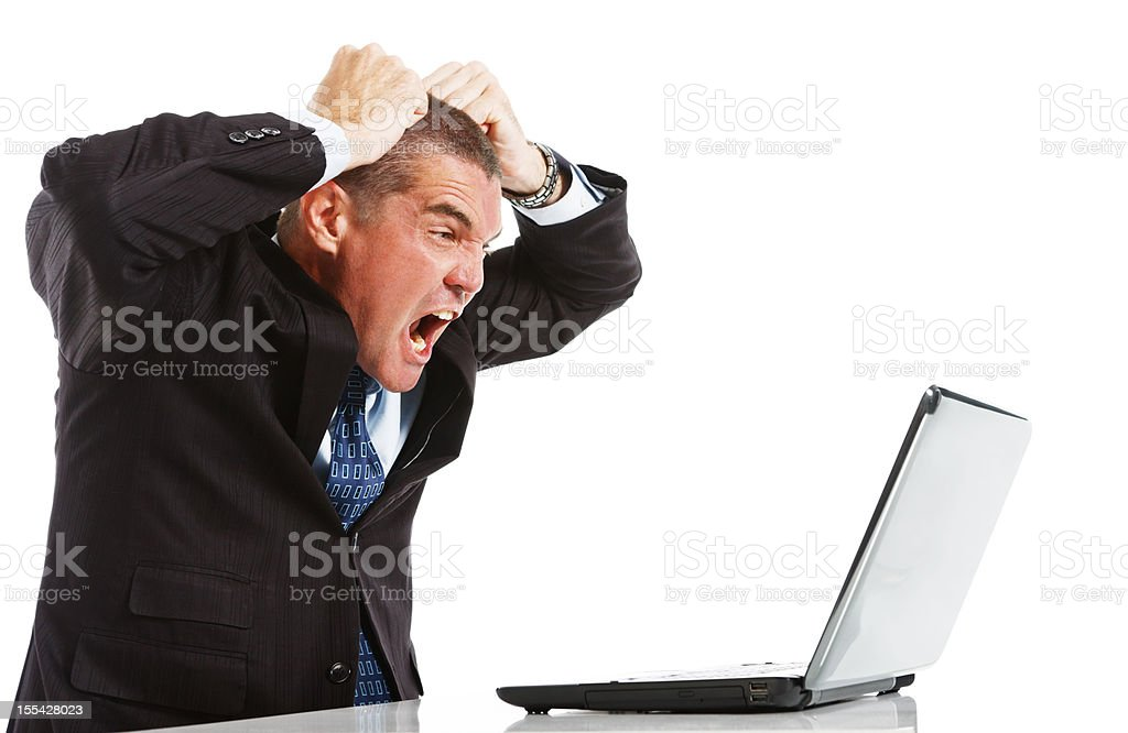 Furious frustrated businessman loses temper with laptop royalty-free stock photo