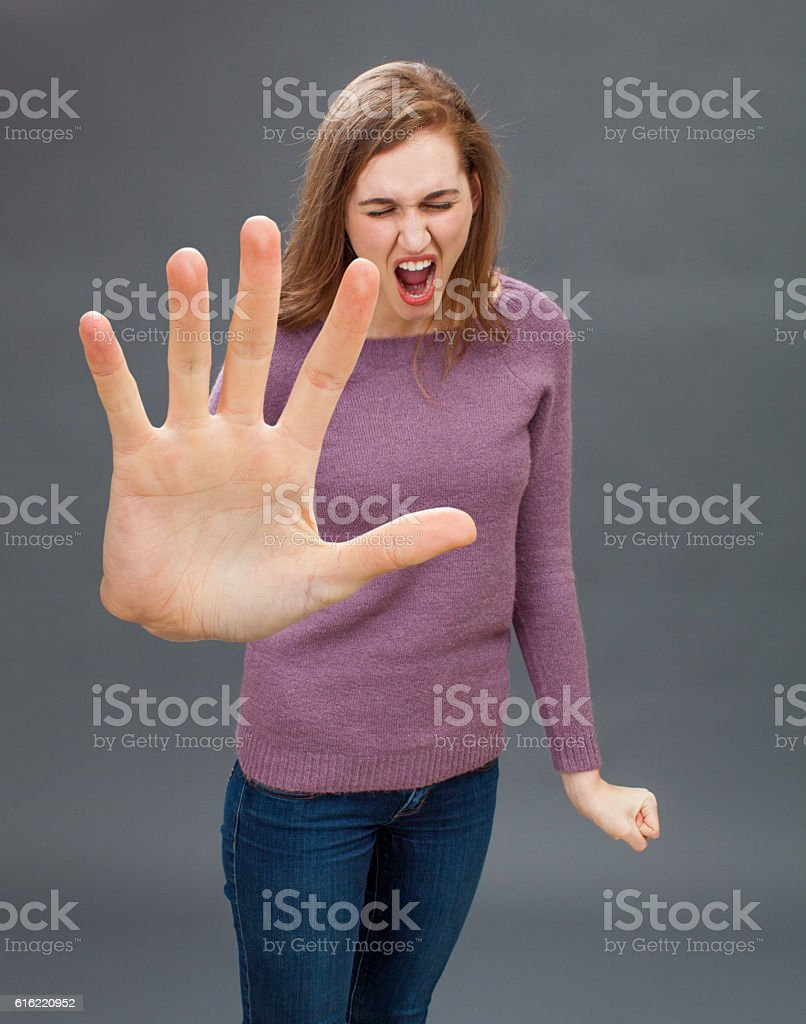 furious girl having tantrum, shouting in showing large hand forward stock photo
