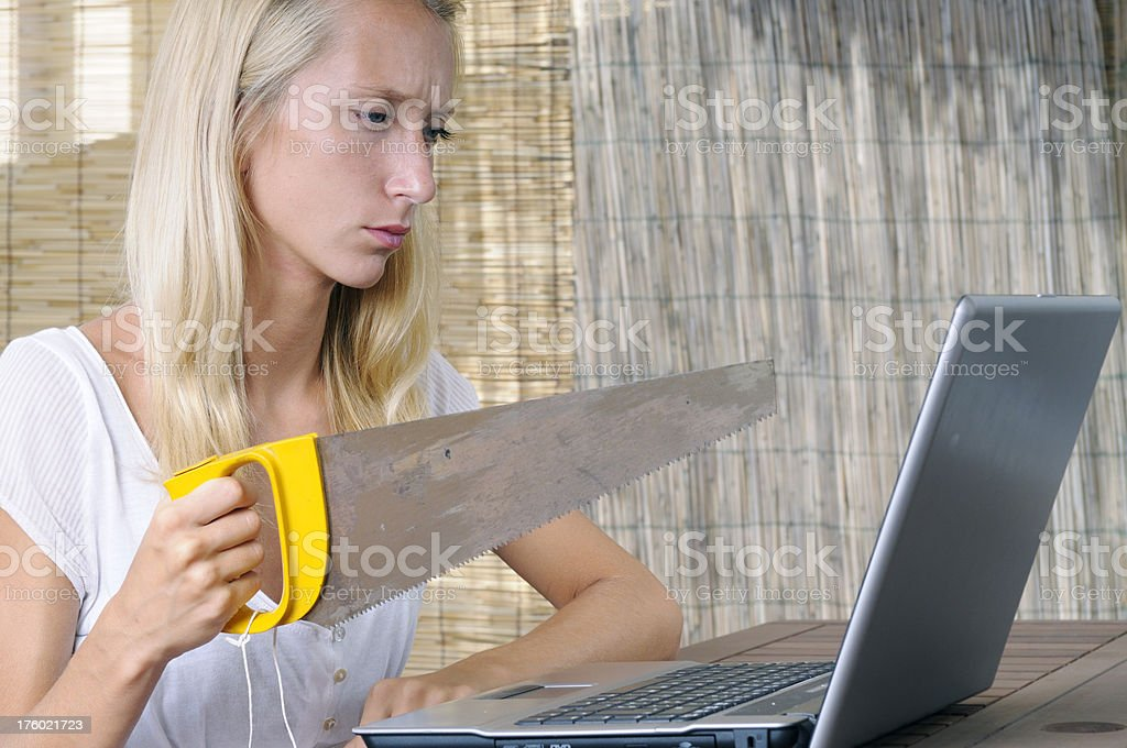 furious girl holding saw royalty-free stock photo