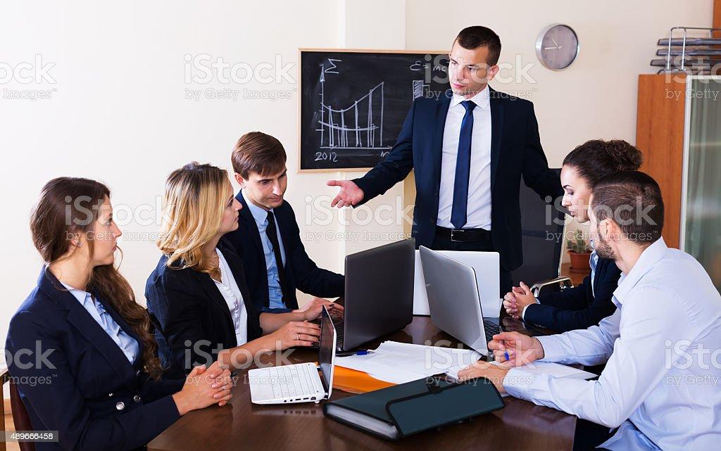 Furious head of company and subordinates stock photo