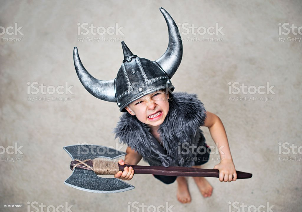 Furious little barbarian with axe stock photo