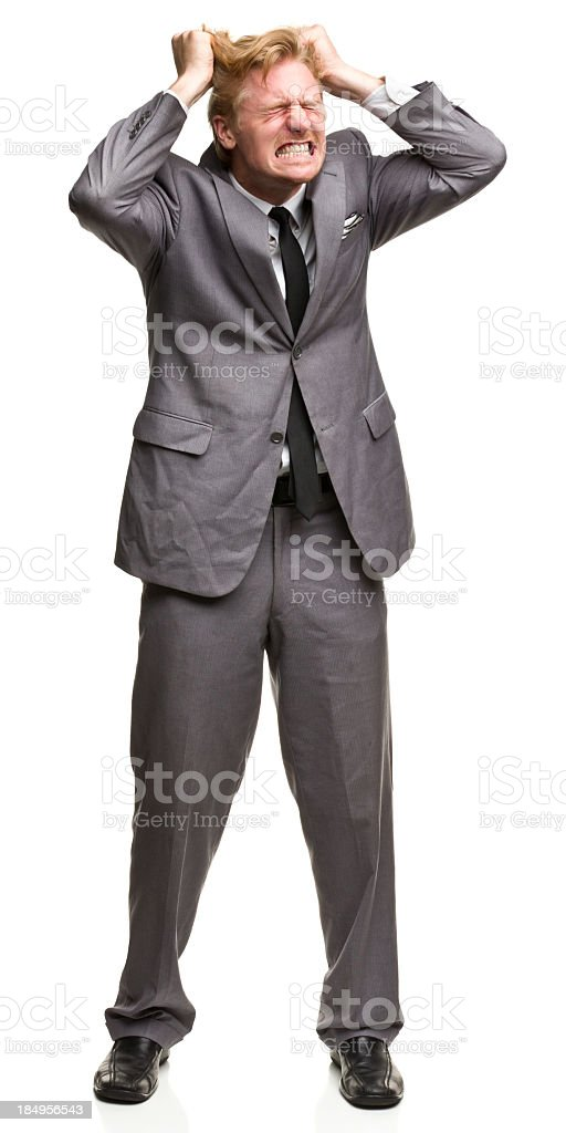 Furious Man in Suit Tearing Out Hair stock photo