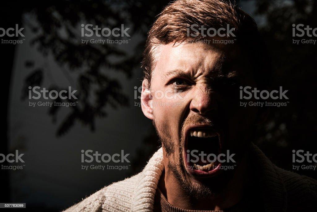 Furious man outdoors. stock photo