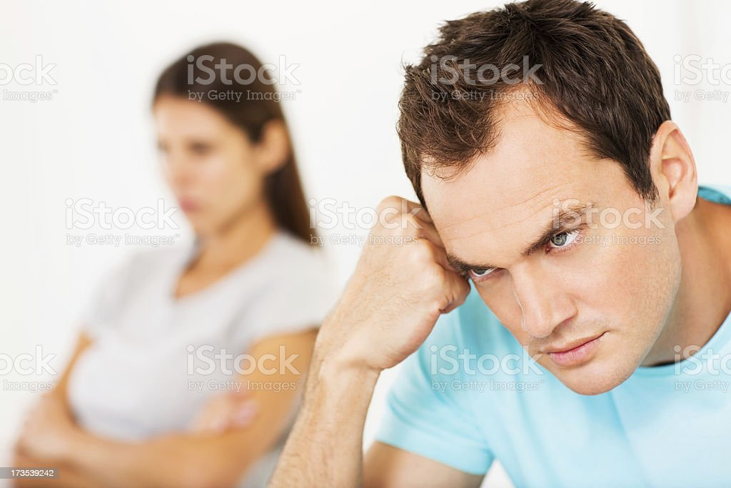 Furious Man With Woman In Background royalty-free stock photo