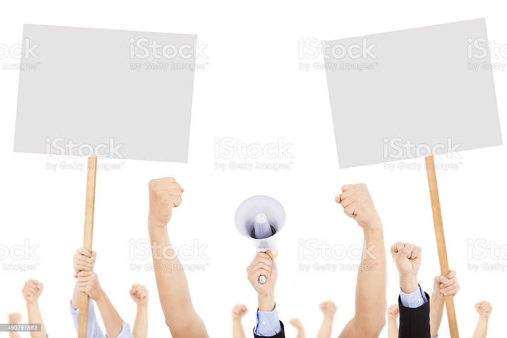 furious people protesting with board and megaphone stock photo