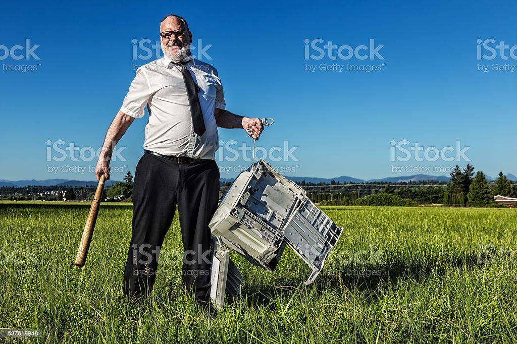 Furious Printer Repairman stock photo