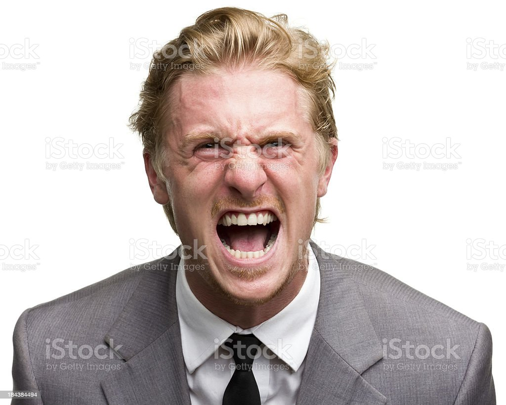 Furious Screaming Man In Suit stock photo