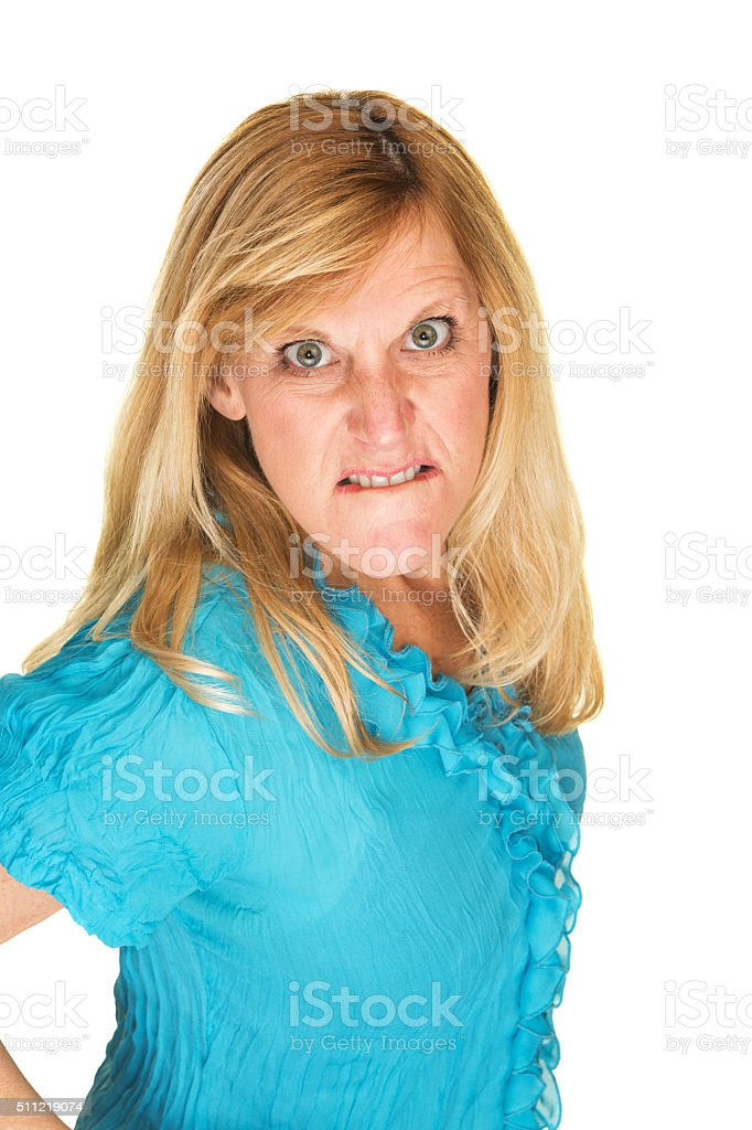 Furious Woman Biting Lips stock photo