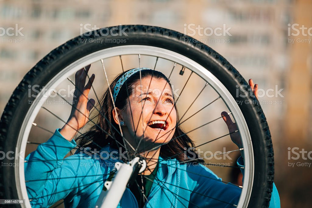 Furious woman with bike problem stock photo