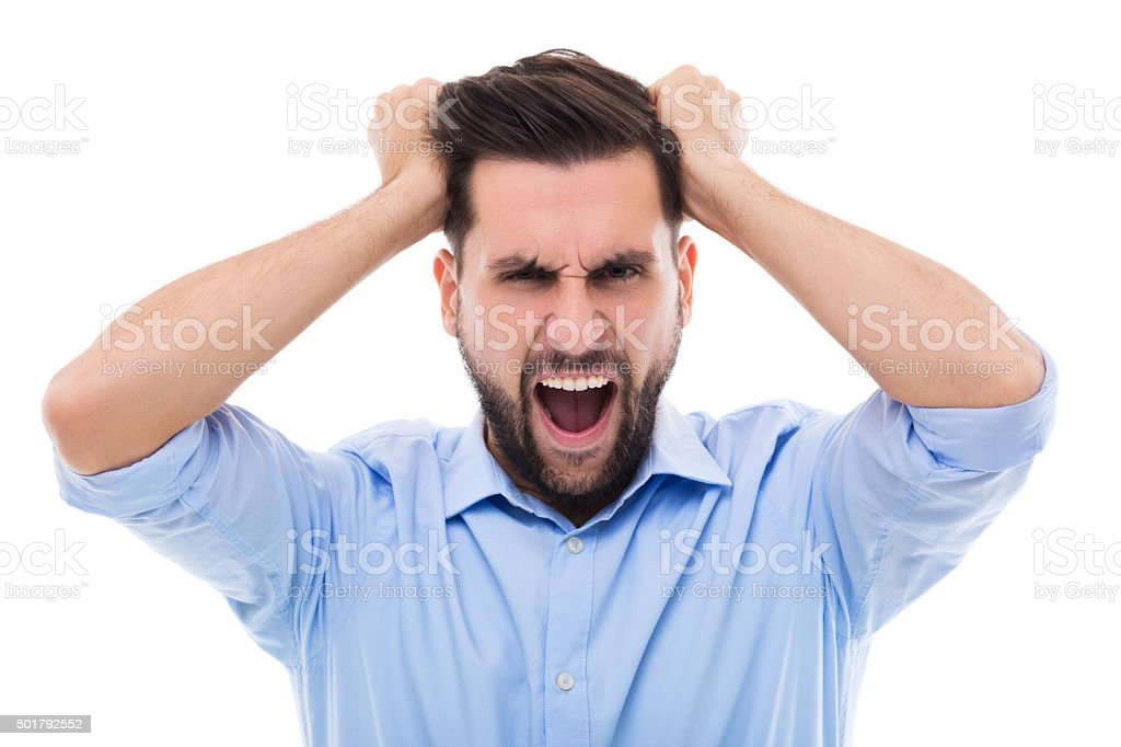 Furious young man stock photo