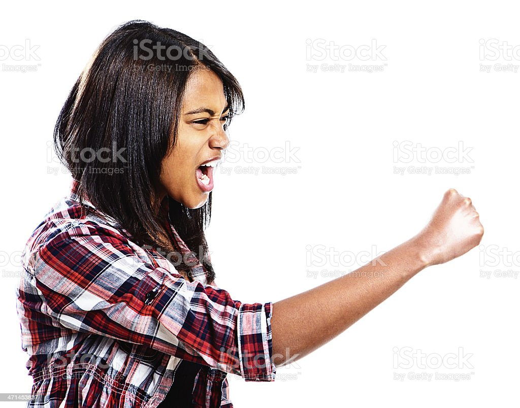 Furious young woman shakes her fist and yells royalty-free stock photo