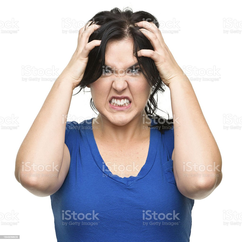 Furious Young Woman Tearing Out Hair royalty-free stock photo