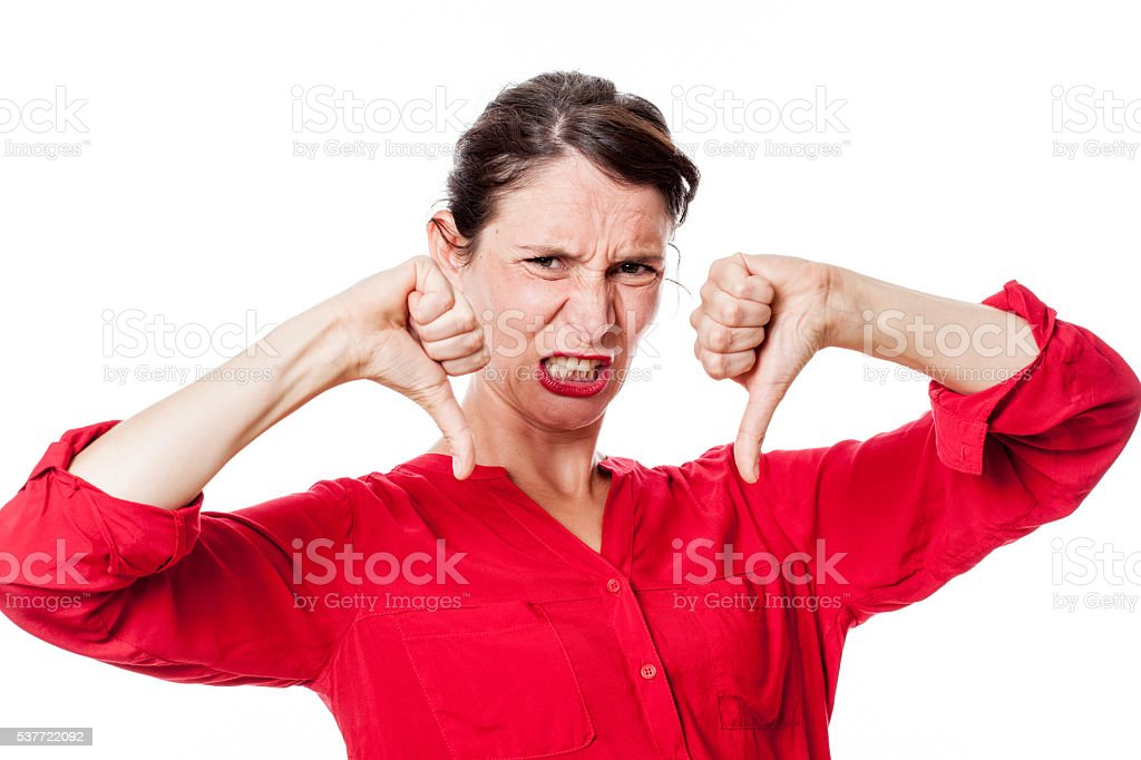 furious young woman with disappointed thumbs down grinding teeth stock photo