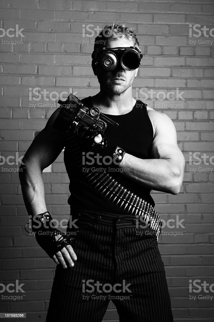 Furistic male with cyborg goggles and weapon stock photo