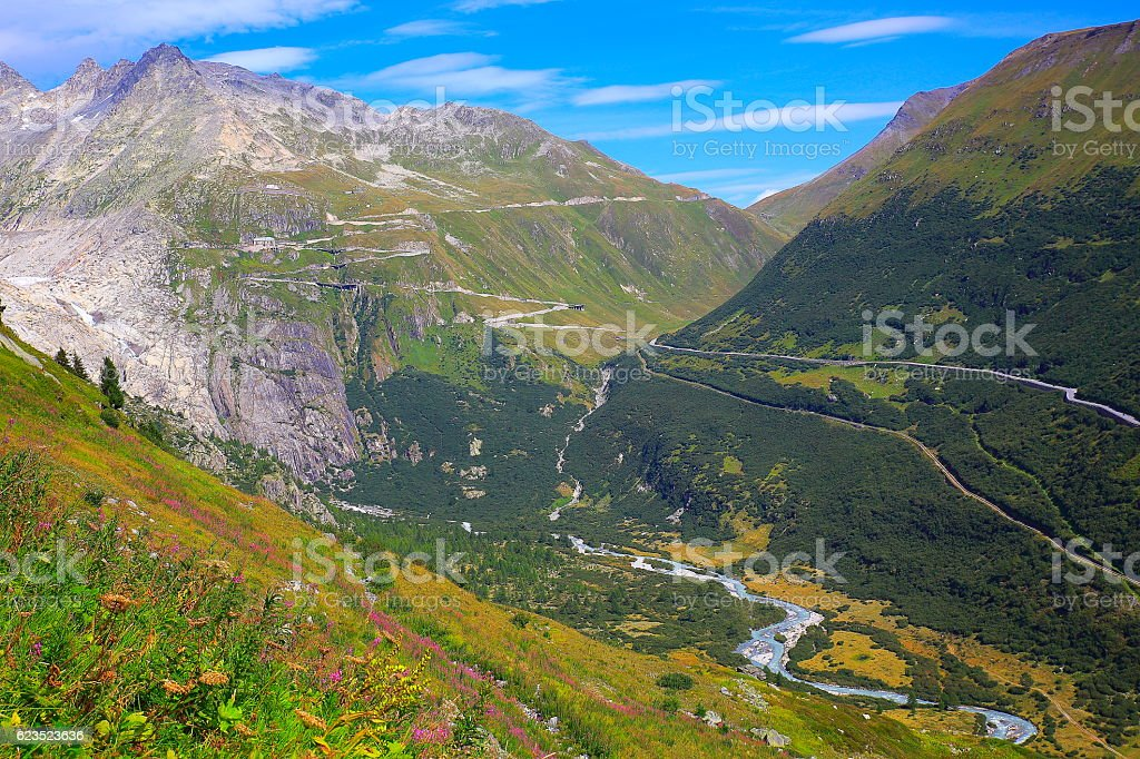 Furka pass alpine landscape from Grimsel pass, Road crossing swiss alps stock photo