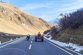 Furkapass. A motorcycle exceeds tractor