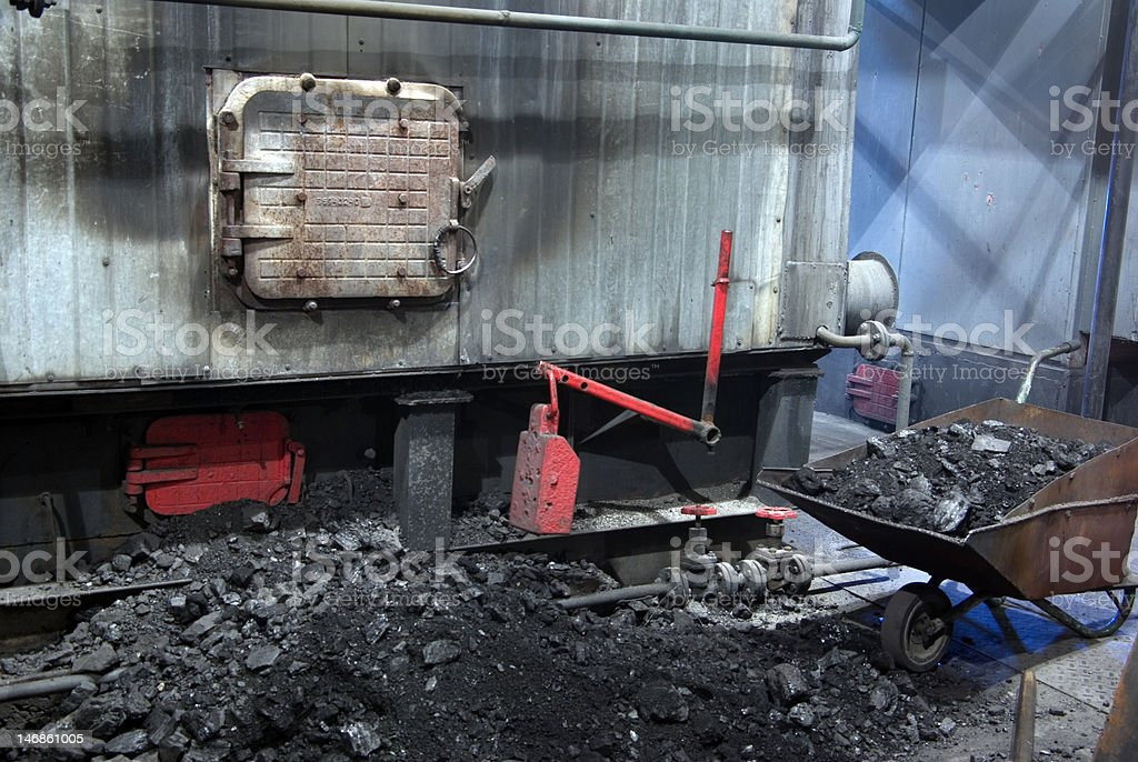 furnace, coals and wheelbarrow workplace royalty-free stock photo