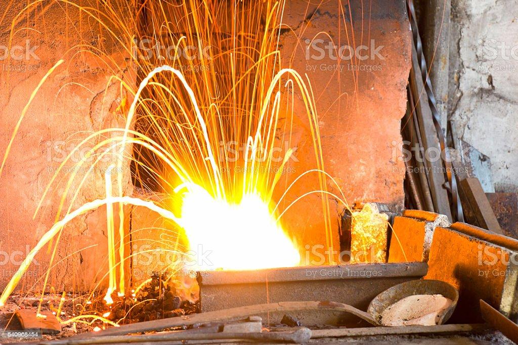 Furnace fire in blacksmith's shop stock photo