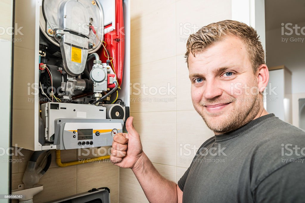Furnace Repairman stock photo