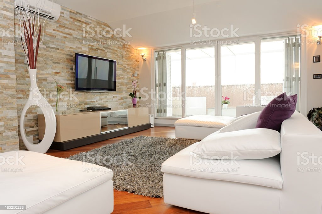 Furnished living room with view of balcony stock photo