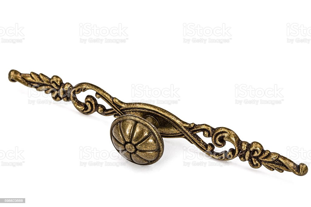 Furniture accessories: Stylish bronze  handles, isolated on a wh stock photo