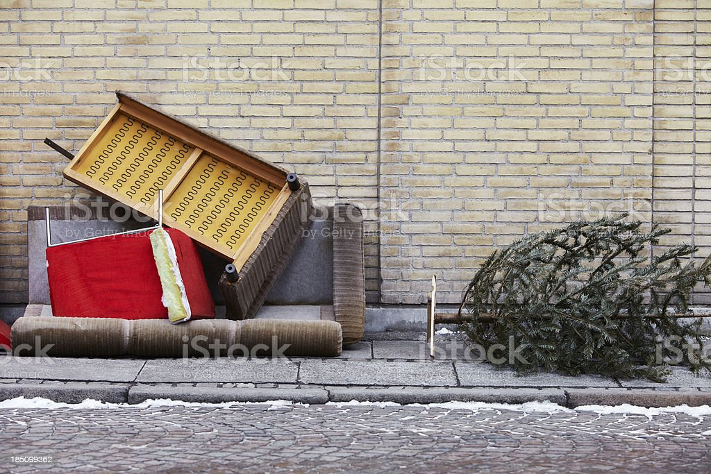 Furniture and christmas tree thrown out stock photo