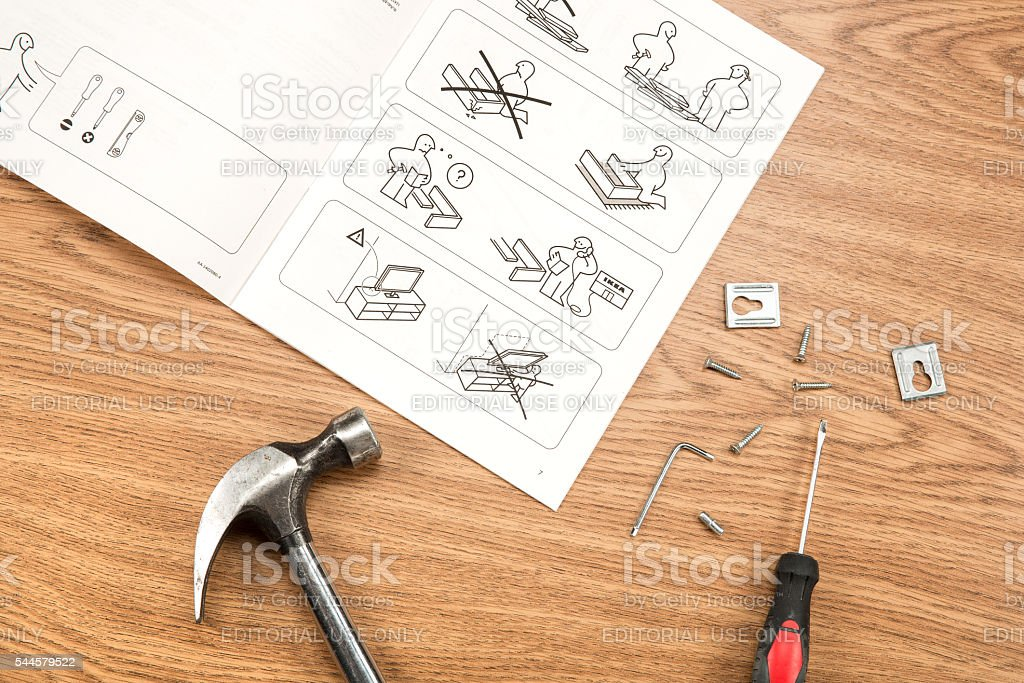 IKEA furniture assembling with instructions and tools. stock photo