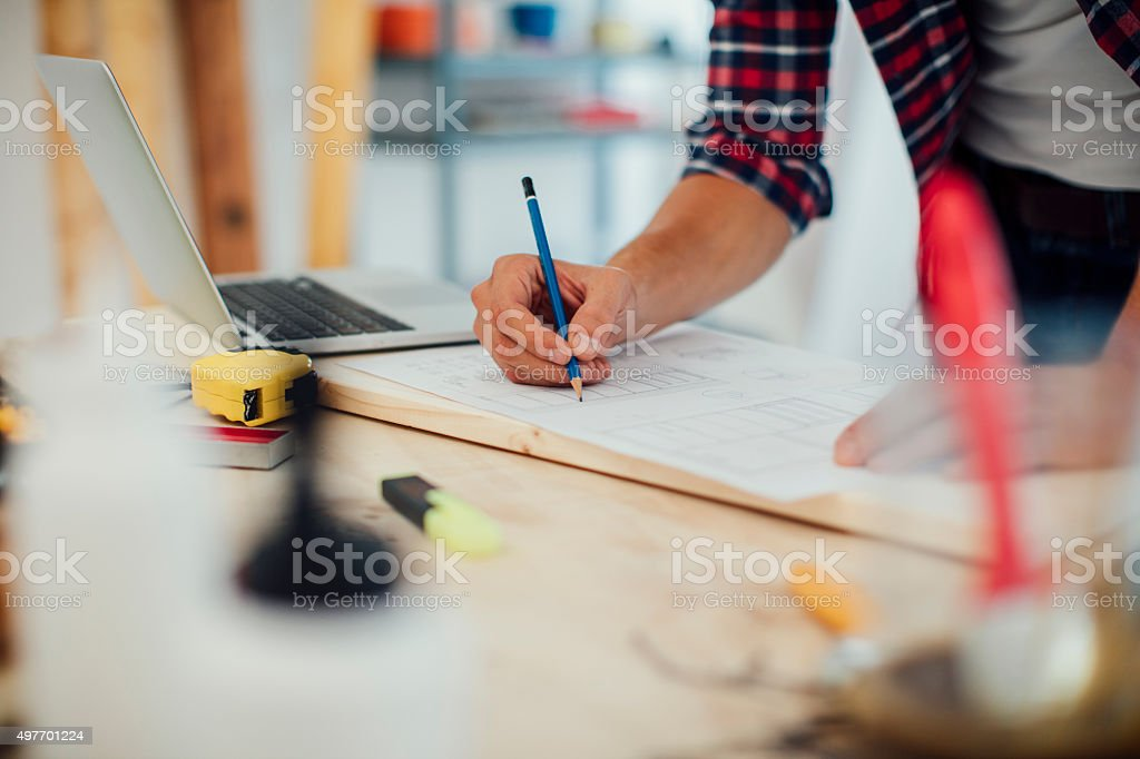 Furniture Designer At Work In His Workshop. stock photo