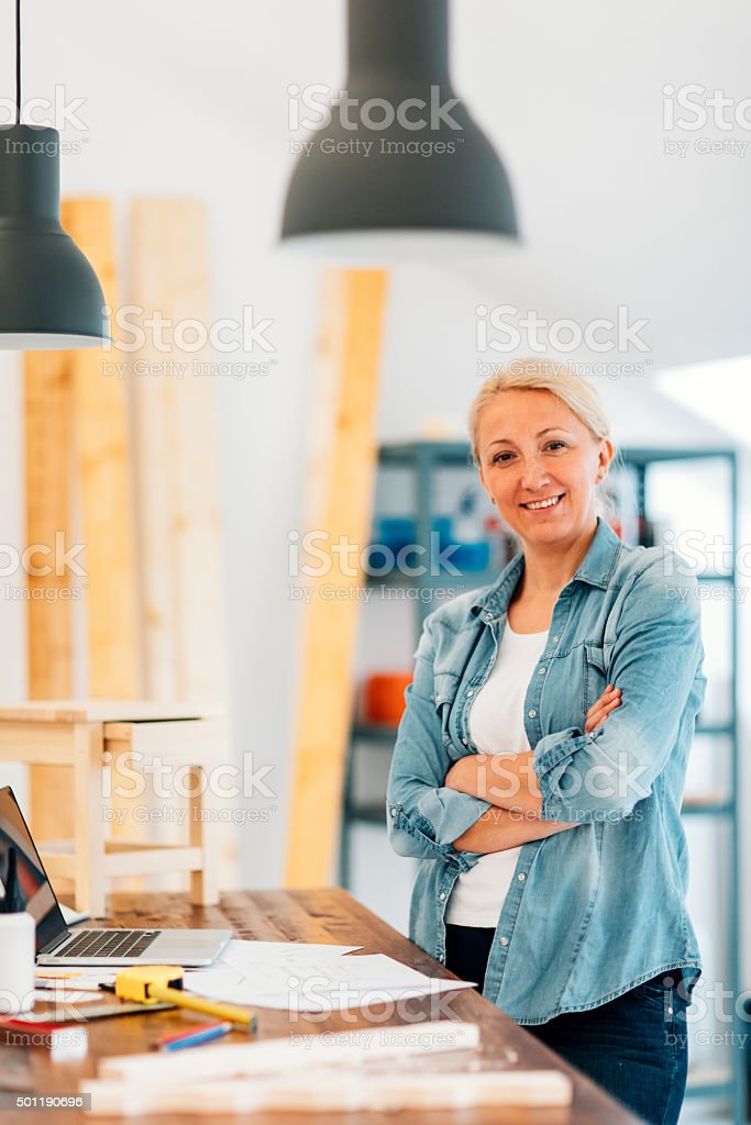 Furniture Designer In Her Workshop. stock photo